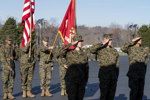 Candidates in Officer Candidate School salute during the 75th aAnniversary of OCS ceremony at Marine Corps.