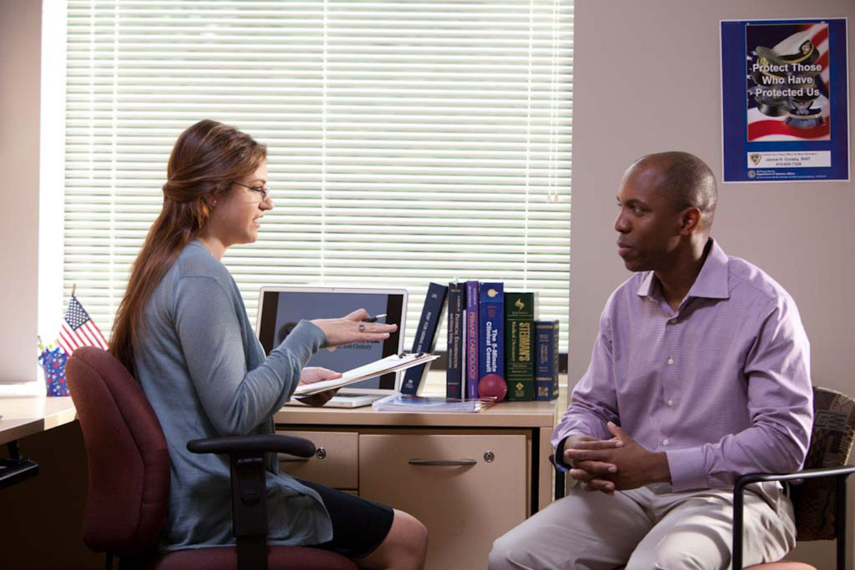 A man and woman talking in an office