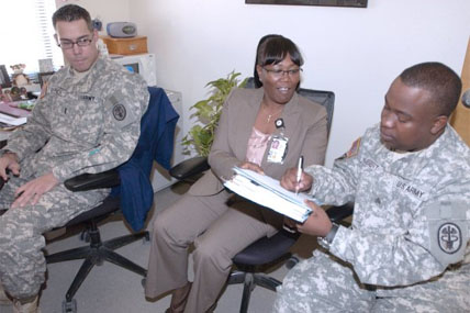soldier signs paperwork 428x285