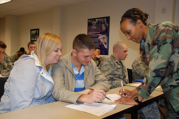 Couple in a discussion with a soldier.