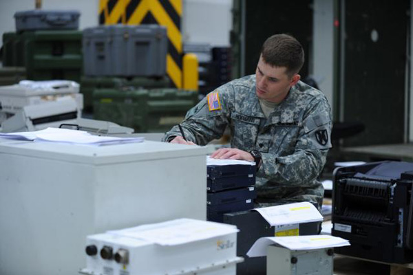 Soldier performing logistical work.