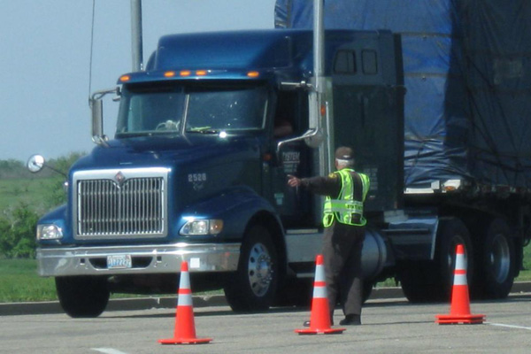 Semi truck driver on a training course test.