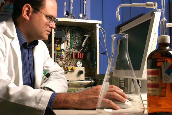 Scientist using a computer.