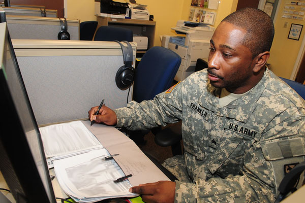 Soldier working at a desk.