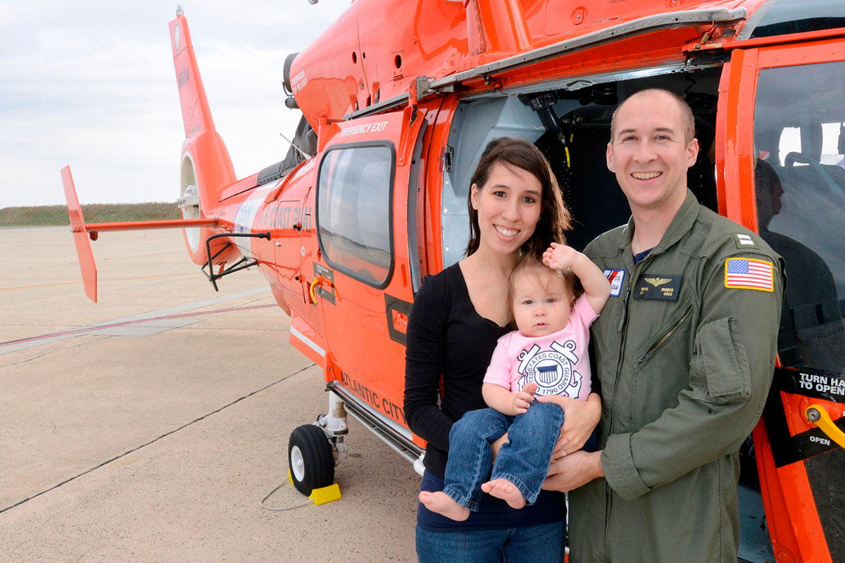 Lt. Nate Rhodes, a helicopter pilot with wife and daughter
