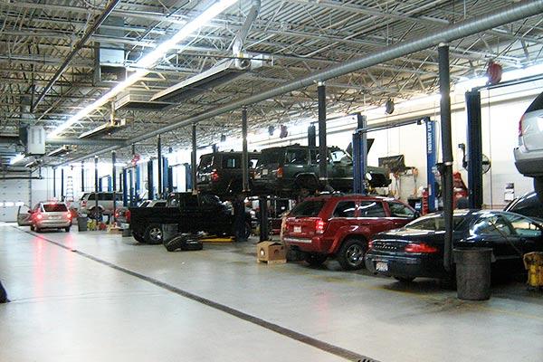 Car dealership garage (Wikipedia photo by Christopher Ziemnowicz)