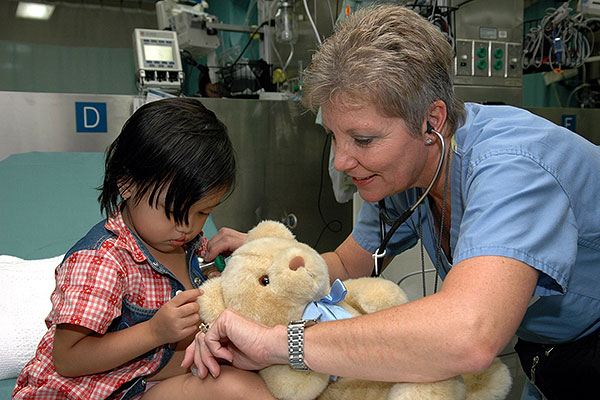 Project Hope nurse Diane Speranza listens to a child's heartbeat while taking her vital signs aboard the U.S. Military Sealift Command (MSC) Hospital ship USNS Mercy (T-AH 19). (U.S. Navy/Photographer's Mate 2nd Class Erika N. Jones)