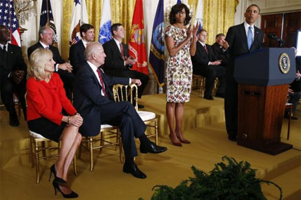 President Barack Obama speaks in the East Room of the White House in Washington, Tuesday, April 30, 2013, about jobs for veterans. From left are, Jill Biden, wife of Vice President Joe Biden, the vice president and first lady Michelle Obama.