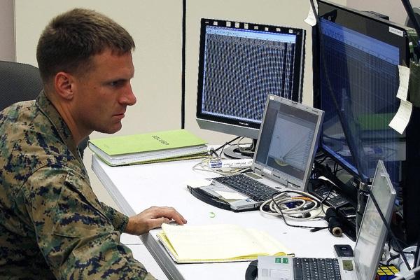 Soldier at desk.
