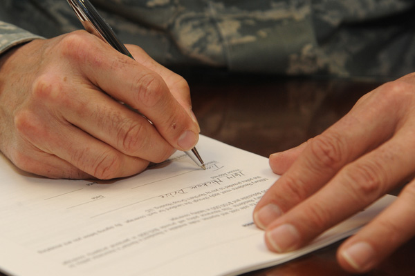 Servicemember signing a contract