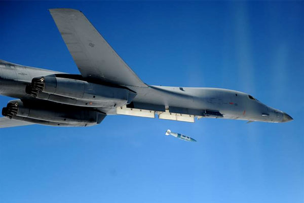 A B-1B Lancer drops a Guided Bomb Unit-31 over the range at Eglin Air Force Base, Fla. (US Air Force/William Singletary)