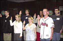 Mission accomplished: Krebs, Johns and other applicants repeat the Oath of Enlistment in the ceremonial room.